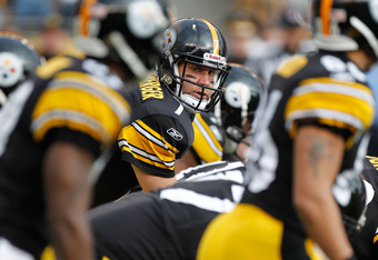 PITTSBURGH, PA - DECEMBER 04:  Ben Roethlisberger #7 of the Pittsburgh Steelers gets ready for a first quarter snap while playing the Cincinnati Bengals at Heinz Field on December 4, 2011 in Pittsburgh, Pennsylvania. Pittsburgh won the game 35-7. (Photo b