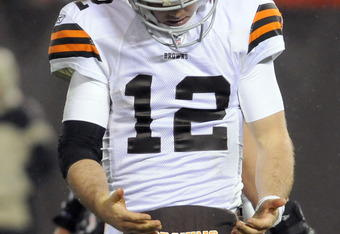 CLEVELAND, OH - DECEMBER 4: Quarterback Colt McCoy #12 of the Cleveland Browns looks to his hands after throwing an incomplete pass during the fourth quarter against the Baltimore Ravens at Cleveland Browns Stadium on December 4, 2011 in Cleveland, Ohio.