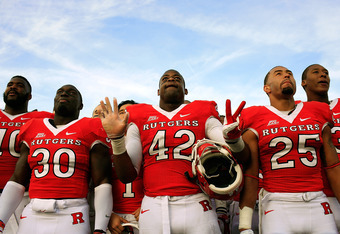 NEW BRUNSWICK, NJ - NOVEMBER 19:  Members of the Rutgers Scarlet Knights celebrate after defeating the Cincinnati Bearcats 20-3 at Rutgers Stadium on November 19, 2011 in New Brunswick, New Jersey.  (Photo by Patrick McDermott/Getty Images)