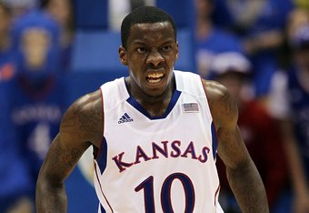 LAWRENCE, KS - DECEMBER 06:  Tyshawn Taylor #10 of the Kansas Jayhawks in action during the game against the Long Beach State 49ers on December 6, 2011 at Allen Fieldhouse in Lawrence, Kansas.  (Photo by Jamie Squire/Getty Images)