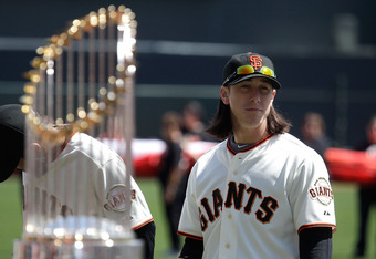 SAN FRANCISCO, CA - APRIL 08:  Tim Lincecum #55 of the San Francisco looks on as he stands next to the 2010 World Series trophy before the start of the Giants' opening day game against the St. Louis Cardinals at AT&T Park on April 8, 2011 in San Francisco