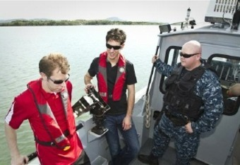 Brad Keselowksi and Joey Logano on patrol with Navy.    Photo credit: Mike Clifton USO
