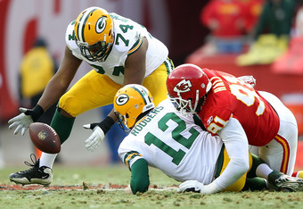 Aaron Rodgers Fumbles After Suffering Another Sack by Kansas City's Tamba Hali