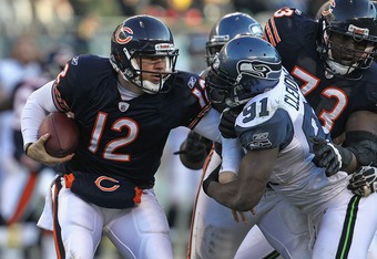CHICAGO, IL - DECEMBER 18:  Chris Clemons #91 of the Seattle Seahawks sacks Caleb Hanie #12 of the Chicago Bears as J'Marcus Webb #73 tries to block at Soldier Field on December18, 2011 in Chicago, Illinois. The Seahawks defeated the Bears 38-14.  (Photo