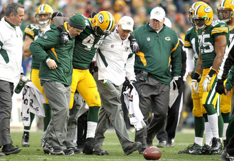 GREEN BAY, WI - NOVEMBER 20:  James Starks #44 of the Green Bay Packers is helped ooff the field after being injured in the fourth quarter against the Tampa Bay Buccaneers at Lambeau Field on November 20, 2011 in Green Bay, Wisconsin.  (Photo by Matthew S