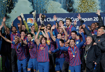 YOKOHAMA, JAPAN - DECEMBER 18: Barcelona captain Carles Puyol (4L) lifts the trophy amongst team-mates celebrating after the FIFA Club World Cup Final match between Santosl and Barcelona at the Yokohama International Stadium on December 18, 2011 in Yokoha