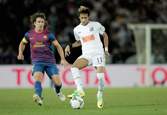 YOKOHAMA, JAPAN - DECEMBER 18:  Neymar (R) of Santos challenged by Carles Puyol of FC Barcelona during the FIFA Club World Cup Final match between Santosl and Barcelona at the Yokohama International Stadium on December 18, 2011 in Yokohama, Japan.  (Photo