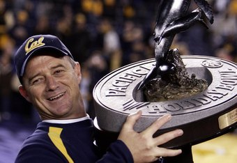 Cal coach Jeff Tedford hoists the 2006 Holiday Bowl Trophy