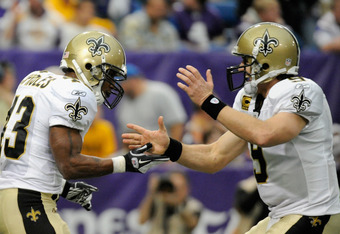 MINNEAPOLIS, MN - DECEMBER 18: Darren Sproles #43 and Drew Brees #9 of the New Orleans Saints celebrate a touchdown against the Minnesota Vikings during the second quarter on December 18, 2011 at Mall of America Field at the Hubert H. Humphrey Metrodome i