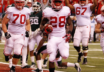 INDIANAPOLIS, IN - DECEMBER 03:  Montee Ball #28 of the Wisconsin Badgers celebrates along with his teammates afte he scored his second 6-yard rushing touchdown in the first quarter against the Michigan State Spartans during the Big 10 Conference Champion