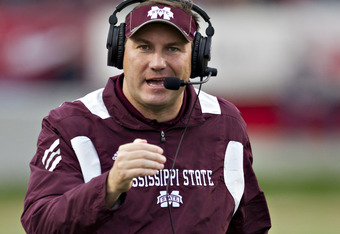 LITTLE ROCK, AR - NOVEMBER 19:   Head Coach Dan Mullen of the Mississippi State Bulldogs talks into his headset during a game against the Arkansas Razorbacks at War Memorial Stadium on November 19, 2011 in Little Rock, Arkansas. The Razorbacks defeated th