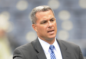 KANSAS CITY, MO - APRIL 05: General Manager Dayton Moore of the Kansas City Royals visits on the field prior to the 2010 home opener against the Detroit Tigers on April 5, 2010 at Kauffman Stadium in Kansas City, Missouri. (Photo by G. Newman Lowrance/Get