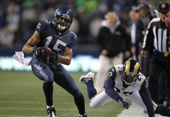 SEATTLE, WA - DECEMBER 12:  Wide receiver Doug Baldwin #15 of the Seattle Seahawks rushes against the St. Louis Rams at CenturyLink Field on December 12, 2011 in Seattle, Washington. (Photo by Otto Greule Jr/Getty Images)