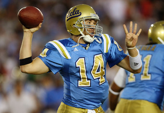 PASADENA, CA - OCTOBER 06:  Quarterback McLeod Bethel-Thompson #14 of the UCLA Bruins throws a pass against the Notre Dame Fighting Irish on October 6, 2007 at the Rose Bowl in Pasadena, California.  (Photo by Stephen Dunn/Getty Images)