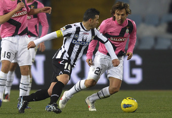 UDINE, ITALY - DECEMBER 21: (L - R) Antonio Di Natale of Udinese competes with Andrea Pirlo of Juventus during the Serie A match between Udinese Calcio and Juventus FC at Stadio Friuli on December 21, 2011 in Udine, Italy.  (Photo by Dino Panato/Getty Ima