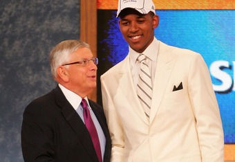 NEW YORK - JUNE 28:  NBA Commissioner David Stern (L) shakes hands with Nick Young of Southern California after he was drafted 16th by the Washington Wizards during the 2007 NBA Draft at the WaMu Theatre at Madison Square Garden June 28, 2007 in New York