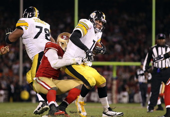 SAN FRANCISCO, CA - DECEMBER 19:  Ben Roethlisberger #7 of the Pittsburgh Steelers is sacked by Aldon Smith #99 of the San Francisco 49ers at Candlestick Park on December 19, 2011 in San Francisco, California.  (Photo by Ezra Shaw/Getty Images)