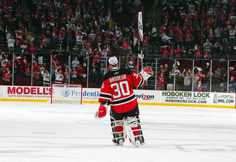 NEWARK, NJ - APRIL 23:  Martin Brodeur #30 of the New Jersey Devils salutes the crowd as he is named star of the game against the Carolina Hurricanes after Game Five of the Eastern Conference Quarterfinal Round of the 2009 NHL Stanley Cup Playoffs on Apri
