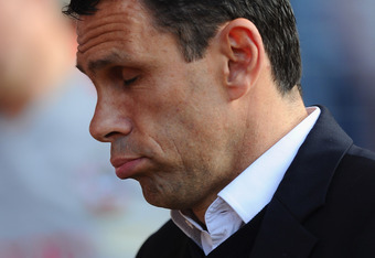 SOUTHAMPTON, ENGLAND - NOVEMBER 19:  Brighton manager Gus Poyet looks on during the npower Championship match between Southampton and Brighton & Hove Albion at St Mary's Stadium on November 19, 2011 in Southampton, England.  (Photo by Mike Hewitt/Getty Im