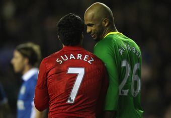 WIGAN, ENGLAND - DECEMBER 21: Ali Al Habsi (R) of Wigan Athletic and Luis Suarez (L) of Liverpool during the Barclays Premier League match between Wigan Athletic and Liverpool at the DW Stadium on December 21, 2011 in Wigan, England.  (Photo by Michael St