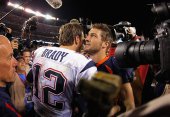 DENVER, CO - DECEMBER 18:  Quarterbacks Tom Brady #12 of the New England Patriots and Tim Tebow #15 of the Denver Broncos meet at midfield after the game at Sports Authority Field at Mile High on December 18, 2011 in Denver, Colorado. The Patriots defeate