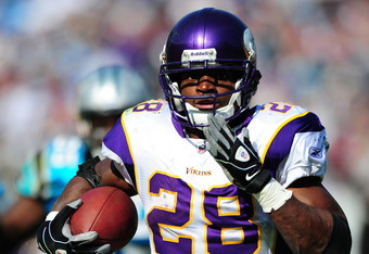 CHARLOTTE, NC - OCTOBER 30: Adrian Peterson #28 of the Minnesota Vikings runs with a catch for a touchdown against the Carolina Panthers at Bank of America Stadium on October 30, 2011 in Charlotte, North Carolina. (Photo by Scott Cunningham/Getty Images)