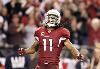 GLENDALE, AZ - DECEMBER 18:  Wide receiver Larry Fitzgerald #11 of the Arizona Cardinals celebrates after a 32 yard reception against the Cleveland Browns during overtime of the NFL game at the University of Phoenix Stadium on December 18, 2011 in Glendal