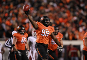 STILLWATER, OK - DECEMBER 03:  Davidell Collins #98 of the Oklahoma State Cowboys at Boone Pickens Stadium on December 3, 2011 in Stillwater, Oklahoma.  (Photo by Ronald Martinez/Getty Images)
