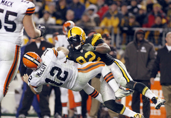 PITTSBURGH, PA - DECEMBER 8:   James Harrison #92 of the Pittsburgh Steelers tackles  Colt McCoy #12 of the Cleveland Browns during the game on December 8, 2011 at Heinz Field in Pittsburgh, Pennsylvania.  The Steelers won 14-3.  (Photo by Justin K. Aller
