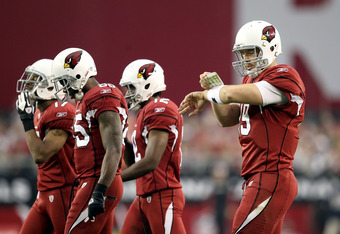 GLENDALE, AZ - DECEMBER 18:  Quarterback John Skelton #19 of the Arizona Cardinals checks his play card as he walks up to the line of scrimmage during the NFL game against the Cleveland Browns at the University of Phoenix Stadium on December 18, 2011 in G