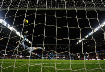 BIRMINGHAM, ENGLAND - DECEMBER 21: Robin Van Persie of Arsenal scores the opening goal from the penalty spot during the Barclays Premier League match between Aston Villa and Arsenal at Villa Park on December 21, 2011 in Birmingham, England.  (Photo by Lau