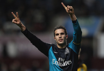 BIRMINGHAM, ENGLAND - DECEMBER 21:  Robin Van Persie of Arsenal celebrates at the end of the match during the Barclays Premier League match between Aston Villa and Arsenal at Villa Park on December 21, 2011 in Birmingham, England.  (Photo by Clive Mason/G