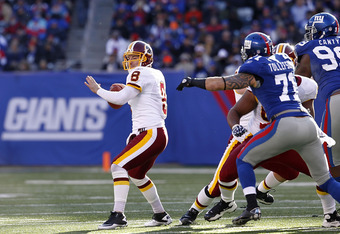 EAST RUTHERFORD, NJ - DECEMBER 18:  Rex Grossman #8 of the Washington Redskins looks for an open man during a game against the New York Giants at MetLife Stadium on December 18, 2011 in East Rutherford, New Jersey.  (Photo by Jeff Zelevansky/Getty Images)