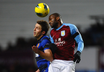 BIRMINGHAM, ENGLAND - DECEMBER 03:  Darren Bent of Aston Villa and Michael Carrick of Manchester United go up for a header during the Barclays Premier League match between Aston Villa and Manchester United at Villa Park on December 3, 2011 in Birmingham,