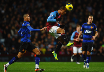 BIRMINGHAM, ENGLAND - DECEMBER 03:  Gabriel Agbonlahor of Aston Villa heads the ball ahead of Chris Smalling of Manchester United during the Barclays Premier League match between Aston Villa and Manchester United at Villa Park on December 3, 2011 in Birmi