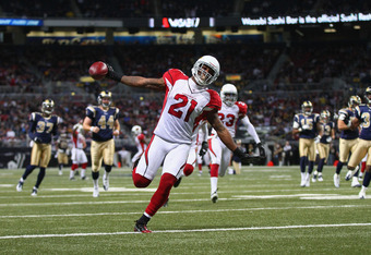 ST. LOUIS, MO - NOVEMBER 27:  Patrick Peterson #21 of the Arizona Cardinals returns a punt for an 80 yard for touchdown against the St. Louis Rams  at the Edward Jones Dome on November 27, 2011 in St. Louis, Missouri.  The Cardinals beat the Rams 23-20.