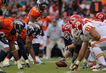 DENVER - NOVEMBER 14:  The Kansas City Chiefs offensive line prepares to snap the ball against the Denver Broncos defense at INVESCO Field at Mile High on November 14, 2010 in Denver, Colorado. The Broncos defeated the Chiefs 49-29.  (Photo by Doug Pensin