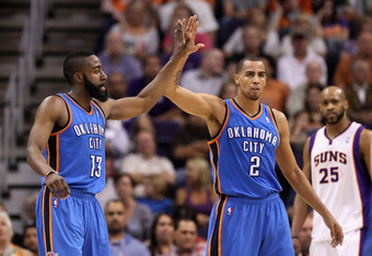 PHOENIX, AZ - MARCH 30:  James Harden #13 of the Oklahoma City Thunder high fives teamate Thabo Sefolosha #2 after scoring against the Phoenix Suns during the NBA game at US Airways Center on March 30, 2011 in Phoenix, Arizona. The Thunder defeated the Su