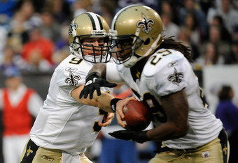 MINNEAPOLIS, MN - DECEMBER 18: Drew Brees #9 of the New Orleans Saints hands the ball to Chris Ivory #29 during the second quarter against the Minnesota Vikings on December 18, 2011 at Mall of America Field at the Hubert H. Humphrey Metrodome in Minneapol
