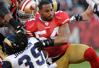 SAN FRANCISCO, CA - DECEMBER 04:  Larry Grant #54 of the San Francisco 49ers loses his helmet while tackling Steven Jackson #39 of the St Louis Rams at Candlestick Park on December 4, 2011 in San Francisco, California. The 49ers won the game 26-0. (Photo