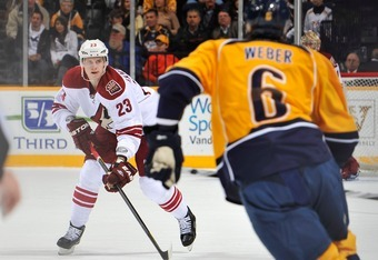 NASHVILLE, TN - DECEMBER 06:  Oliver Ekman-Larsson #23 of the Phoenix Coyotes skates against Shea Weber #6 of the Nashville Predators at the Bridgestone Arena on December 6, 2011 in Nashville, Tennessee.  (Photo by Frederick Breedon/Getty Images)