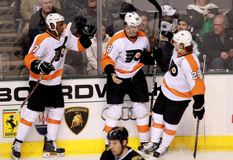 DALLAS, TX - DECEMBER 21:  Jaromir Jagr #68 of the Philadelphia Flyers celebrates his goal with Claude Giroux #28 and Wayne Simmonds #17 during play against the Dallas Stars at American Airlines Center on December 21, 2011 in Dallas, Texas.  (Photo by Ron
