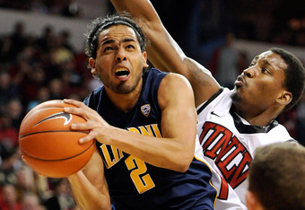 LAS VEGAS, NV - DECEMBER 23:  Jorge Gutierrez #2 of the California Golden Bears drives to the basket against Quintrell Thomas #1 of the UNLV Rebels during their game at the Thomas & Mack Center December 23, 2011 in Las Vegas, Nevada. UNLV won 85-68.  (Pho