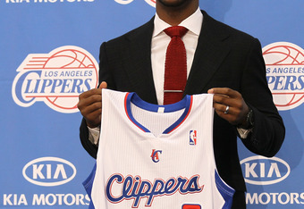 PLAYA VISTA, CA - DECEMBER 15:  Chris Paul holds up his jersey at a press conference introducing him as a member of the Los Angeles Clippers on December 15, 2011 at the Los Angeles Clippers Training Center in Playa Vista, California.  (Photo by Stephen Du