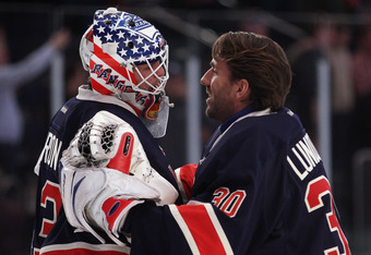 NEW YORK, NY - NOVEMBER 06: Henrik Lundqvist #30 (R) congratulates Martin Biron #43 (L) of the New York Rangers on his 3-0 shutout against the Winnipeg Jets at Madison Square Garden on November 6, 2011 in New York City. (Photo by Bruce Bennett/Getty Image