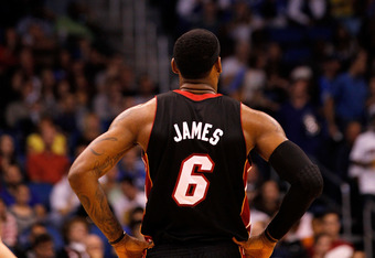 ORLANDO, FL - DECEMBER 21:  LeBron James #6 of the Miami Heat looks on during a preseason game against the Orlando Magic at Amway Center on December 21, 2011 in Orlando, Florida. NOTE TO USER: User expressly acknowledges and agrees that, by downloading an
