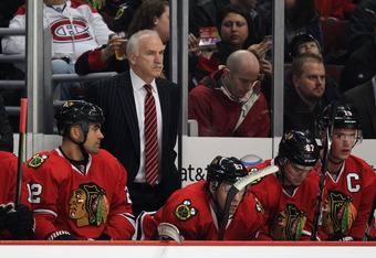 CHICAGO, IL - DECEMBER 21: Head coach Joel Quenneville of the Chicago Blackhawks watches as his team takes on the Montreal Canadiens at the United Center on December 21, 2011 in Chicago, Illinois. The Blackhawks defeated the Canadiens 5-1. (Photo by Jonat