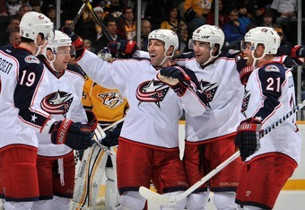 NASHVILLE, TN - DECEMBER 22:  Ryan Johansen #19 , Mark Letestu #17, RJ Umberger#18, Derick Brassard #16, and James Wisniewski #21 of the Columbus Blue Jackets celebrate a goal with their teammates against the Nashville Predators at Bridgestone Arena on De