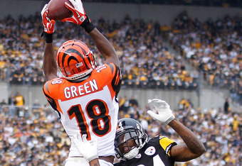 PITTSBURGH, PA - DECEMBER 04:  A.J. Green #18 of the Cincinnati Bengals tries to catch a second quarter pass next to Ike Taylor #24 of the Pittsburgh Steelers but ends up drifting out of bounds at Heinz Field on December 4, 2011 in Pittsburgh, Pennsylvani