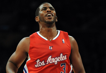 LOS ANGELES, CA - DECEMBER 19:  Chris Paul #3 of the Los Angeles Clippers reacts to a call during his dribble against the Los Angeles Lakers at Staples Center on December 19, 2011 in Los Angeles, California. NOTE TO USER: User expressly acknowledges and a